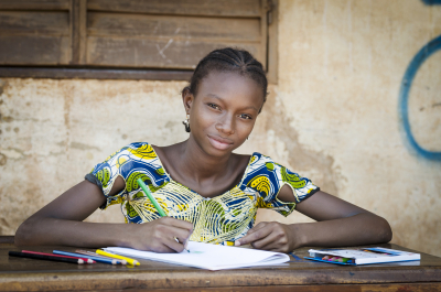 african young girl writing notes